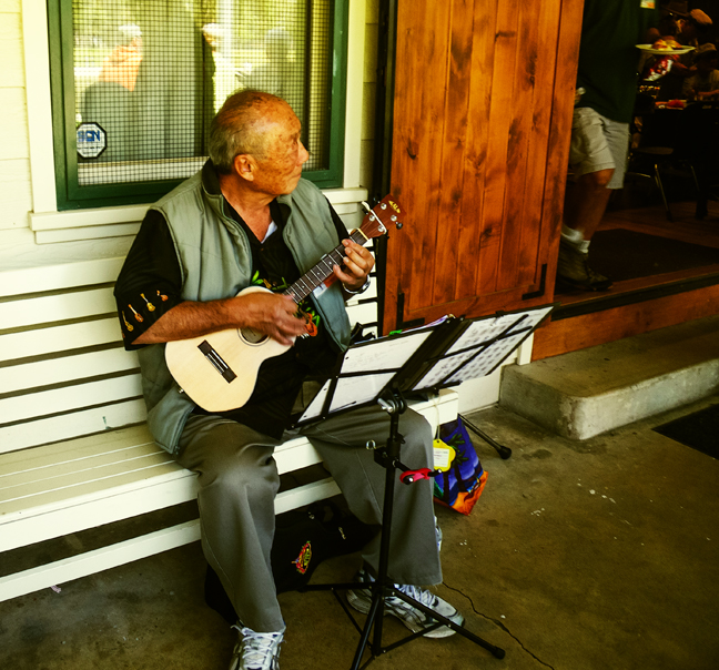 Ken Yoshihara plays some beautiful hawaiian music for the Double Haul lunch recess. photo by Al Q