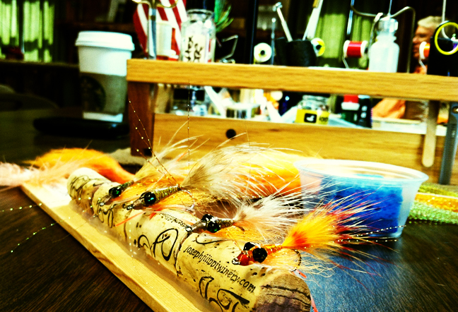 Somes of Dave Valadez's beautifully crafted, epoxy flies. photo by Roy Fukushima