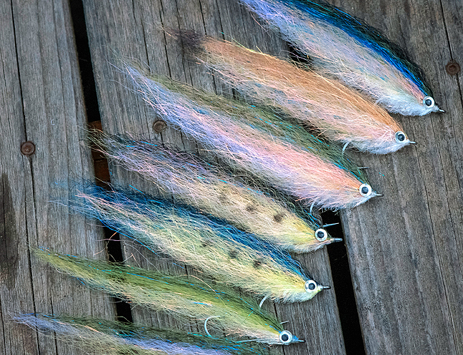 an assortment of Al Q baitfish flies tied with sf blend. photo by Al Q