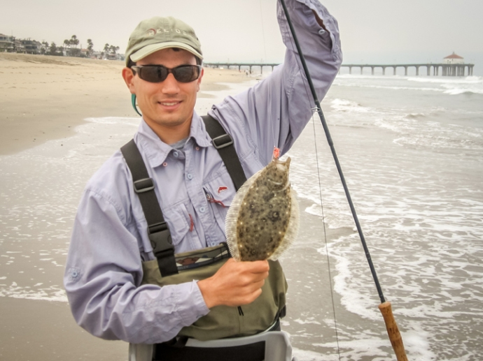 Southbay club member, Jim Kuehne lands a pancake halibut on the fly off of 14th street in Manhattan Beach. Photo courtesy of Jim Kuehne.