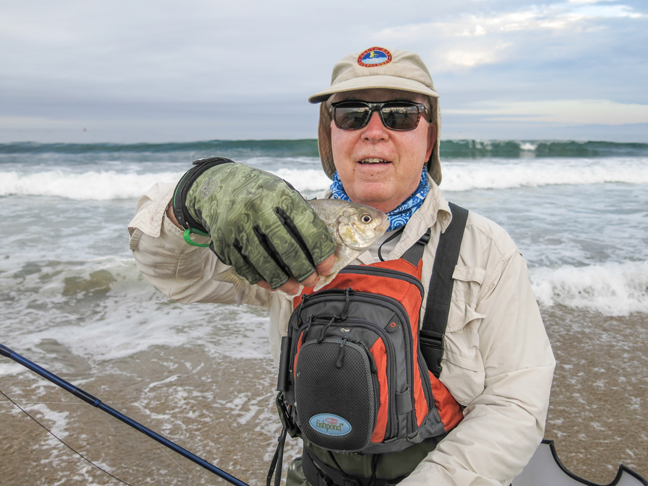 Don Bell with one of his surf perch. photo by Al Q