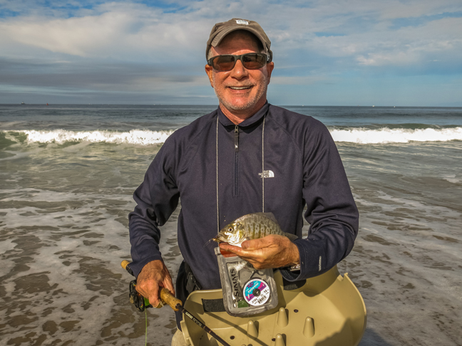 Howard Schecter is all grins after landing a surf perch on a beautiful Sunday morning near LAX. photo by Al Q