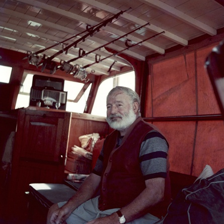Ernest Hemingway in the cabin of his boat, Pilar. photo courtesy of the John F. Kennedy Presidential Library