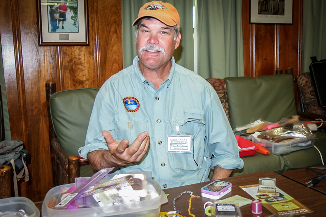 Mike Centofani working the fly tying table. photo by Michael Schweit