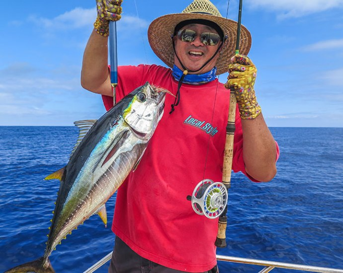 Ken gets his first Ahi on fly. Landed on an eight weight, quite a battle. Photo by Al Quattrocchi