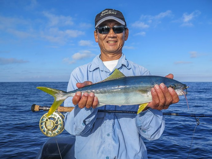 Roy with a nice firecracker yellowtail. Photo by Al Quattrocchi