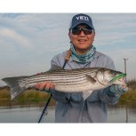 Zino Nakasuji with a PB, 7.5 pound striper. photo by Al Quattrocchi
